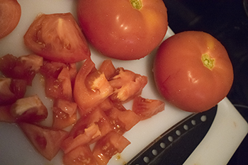 cutting tomatoes, copyright by M. LaFreniere, all rights reserved