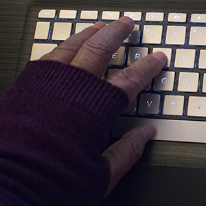 my hand in the fingerless gloves on the keyboard, photo by M. Lafreniere