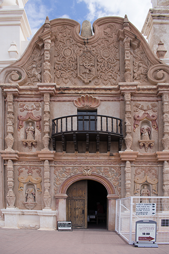 door and front facade decoratedwith saints and animals at Mission San Xavier Del Bac,photo by M. LaFreniere, all rights reserved, CactusCatz